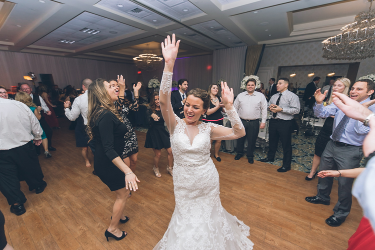 Tara and Dom dancing and celebrating their wedding at Crystal Ballroom, NJ photography by NY NJ Wedding Photographers Pearl Paper Studio.