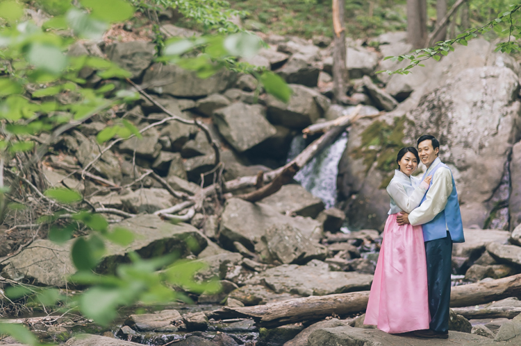 Lisa and John in their colorful han-bok during their romantic engagement photography at Hacklebarney State Park, NJ photography by NY NJ Wedding Photographers Pearl Paper Studio.