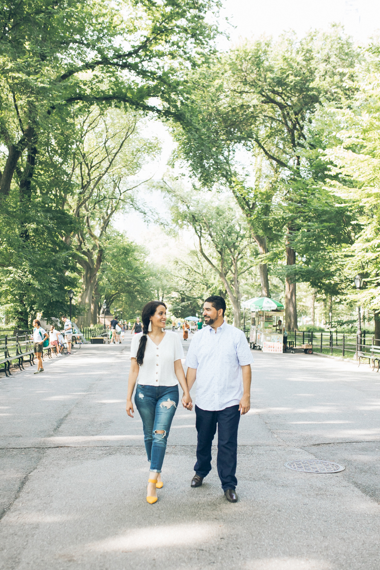 Central Park NY engagement session with Yaliza and Amaury by Bethesda Arcade & Bethesda Fountain captured by Edmund from Pearl Paper Studio, New Jersey, New York and Long Island wedding photography Studio Pearl Paper Studio. Photographing fun, warm and energetic couples on their wedding day is our passion.
