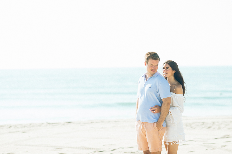Asbury Park NJ ocean front, boardwalk summer engagement session with Pamela and Matt captured by MJ from Pearl Paper Studio, New Jersey, New York and Long Island wedding photography Studio Pearl Paper Studio. Photographing fun, warm and energetic couples on their wedding day is our passion.