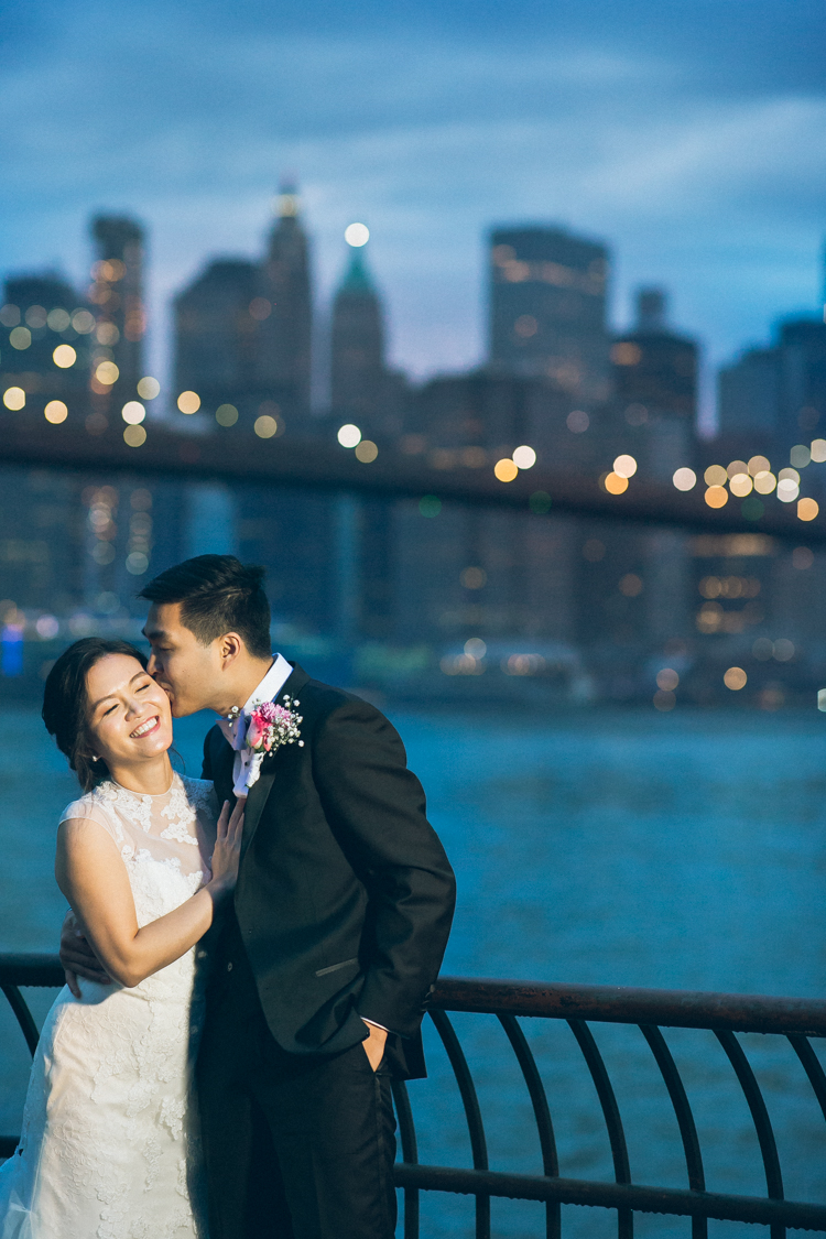 Pearl Paper Studio is in Brooklyn NY photographing Min and Kevin's wedding. Min and Kevin got ready and had Chinese door games at their parents houses in Brooklyn then followed by Chinese wedding banquet at East Harbor Seafood Palace in Brooklyn NY. Min and Kevin along with their bridal party went to Brooklyn Bridge Park for their wedding photos. Sunset and with city lights shining bright in the background Min and Kevin walked around Brooklyn with reach other romantically. Min and Kevin's Brooklyn wedding captured by Edmund and Gabe from Pearl Paper Studio. Pearl Paper Studio wedding photography studio covering New Jersey, New York and Long Island brides and our passion is to photograph fun, warm and energetic couples on their very special wedding day.