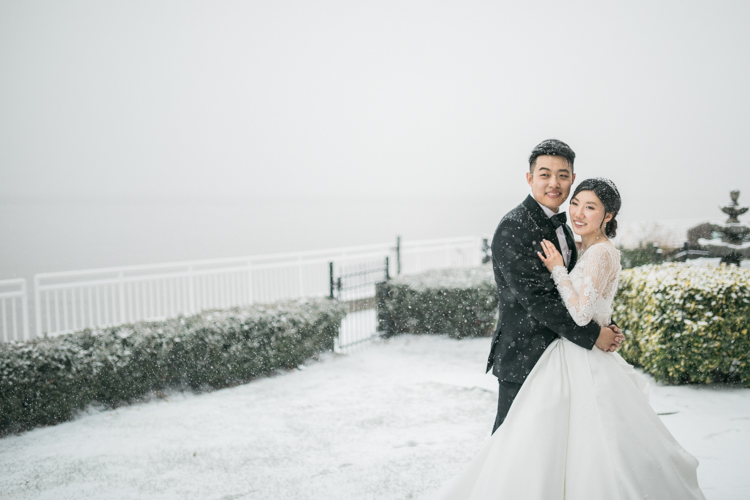 Hudson Valley wedding at The View on the Hudson NY this January when we got first snow storm and everything was covered in white snow. Snow meant very special to Rachel and Andrew, their first date was on a snowy day. Rachel was born on a snowy day, Andrew proposed on a snowy day…So when it started snowing towards the end of their wedding reception Rachel and Andrew right away wanted to go out into the snow and get their wedding photos in the snow. We love such a fun and willing couple! And it was so beautiful and fun photographing in the snow. Rachel and Andrew's winter The View on the Hudson NY wedding. This Korean wedding at The View on the Hudson NY captured by Steve and Jeanie from Pearl Paper Studio. Pearl Paper Studio wedding photography studio covering New Jersey, New York and Long Island brides and our passion is to photograph fun, warm and energetic couples on their very special wedding day.