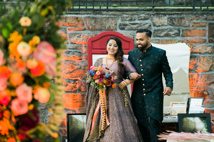 Grace and Tanveer before COVID planned a Spring wedding at Stone Tavern Farm in Roxbury, NY but because of COVID state wide regulations, lockdown Grace and Tanveer decided to postpone their wedding till the Summer. Grace and Tanveer found Tanrackin Farm in Bedford Corners NY for their new wedding in the Summer. Tanrackin Farm established in 1903 having more than 51 acres, cows, horses plus all the farm animals on the property as well as cottage where guests are welcome. Grace and Tanveer's dream farm wedding became reality at Tanrackin Farm it's rustic backdrop, brick wall, stone walkways.Grace and Tanveer's two day wedding celebration at Tanrackin Farm began with outdoor wedding ceremony on the first day with intimate group mainly of just family members with outdoor dinner. On the second day of their wedding Grace and Tanveer held three mini wedding parties hosting three different goops of 50 guests to accommodate their large guest list. Two day wedding celebration was filled with bright colored flowers, fabulous wedding fashion from both bride and groom plus Indian elements by wearing sari on the second day. Grace and Tanveer's rustic Tanrackin Farm wedding captured by Steve and Gabe from Pearl Paper Studio. Pearl Paper Studio is here to capture real emotions, fun couples with non-traditional wedding stories, now we are booking small and intimate backyard wedding, outdoor tent wedding, farm wedding, elopements, nyc elopements. We are currently booking fall 2020 and 2021 weddings in New Jersey, New York and Long Island.