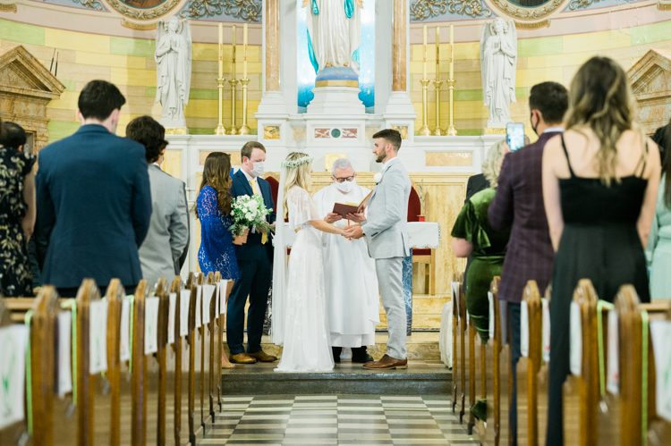 Small Wedding Ceremony at Our Lady of Grace in Fairview, NJ for Keri and Anthony sweet sincere and beautiful wedding ceremony on their original wedding date, small social distanced wedding ceremony at Our Lady of Garce in Fairview NJ where all the guests were masked up except for the bride and groom. Tears were seen in groom Anthony's eyes as he sees his bride Keri walk down the aisle with her father. Keri and Anthony